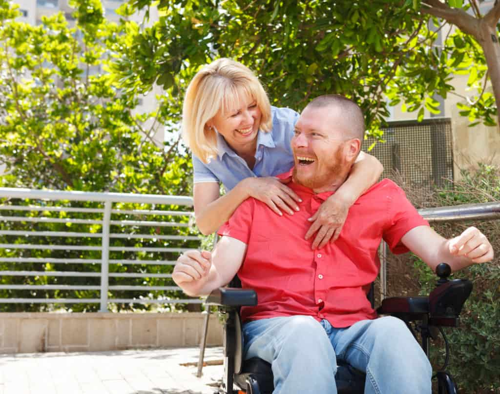 disabled man and caregiver