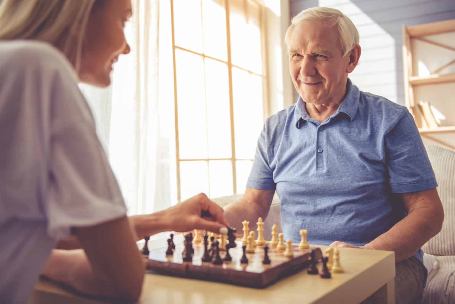 Older couple playing chess